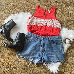 coral and cream sleeveless blouse